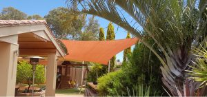 Shade Sails Perth over paved outdoor BBQ area