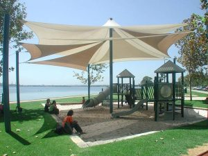 multiple shade sails over a childrens playground