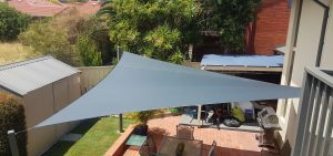 Shade Sails over paved outdoor patio area